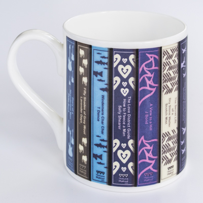 Lakeland book patterned coffee mug handle